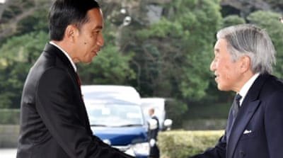 Widodo, left, is expected to sign a defence-cooperation agreement during his visit to Japan [AFP]
