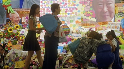 Thousands of tributes were left outside Singapore's General Hospital where Lee passed away on Sunday [AP]
