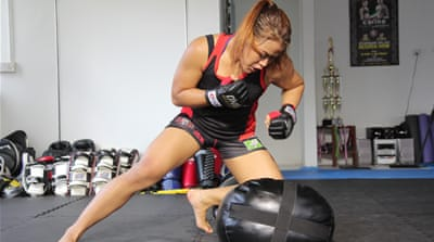 Twenty-eight-year-old Osman has become an unwitting ambassador for MMA and, in the process, a role model for many Asian women [Al Jazeera]