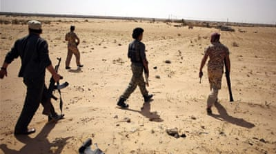 Libya Dawn fighters search for ISIL militants during a patrol near Sirte [Reuters]