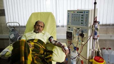 An Iranian kidney patient receives treatment at the dialysis ward at the Helal Iran Clinic in Tehran [AFP]