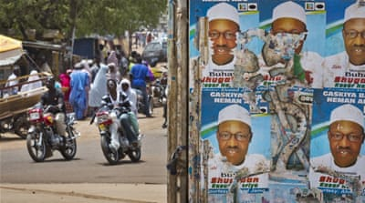 Campaign posters for opposition candidate Buhari at a roundabout in northern Nigeria [AP]