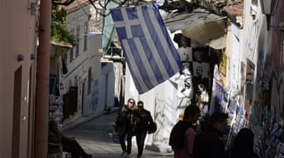 People walk in the Plaka neighbourhood of Athens [AFP]