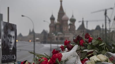 "Flowers and a portrait with the words ""Fight!"" were seen at the site where Nemtsov was gunned down on February 27 [AP]"