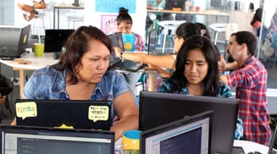 Teacher Gustavo Andres, 25, instructs his female technology students [Alex Pashley/Al Jazeera]