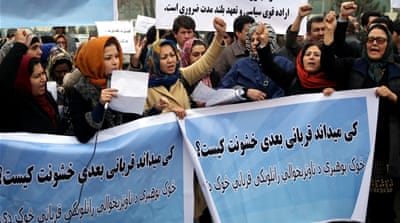 Afghanistan activists participate in a demonstration to protest the increasing violence against women in their country [AP]