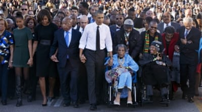 President Obama crossed the bridge holding the hand of Congressman John Lewis [AP]