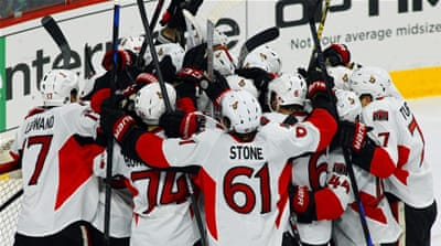 Goal-tender Hammond is mobbed by Ottawa teammates after he stopped 34 shots [AP]