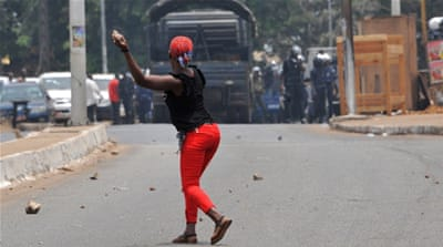Anti-government protesters clash with police in Guinea
