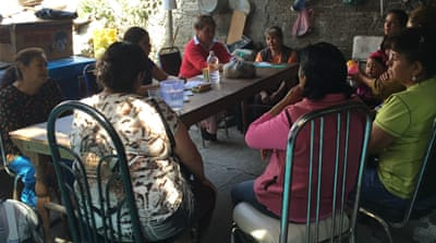Families gather at Efigenia Martinez's home just outside Mexico City to discuss how to break through the red tape [Matt Chandler/Al Jazeera]