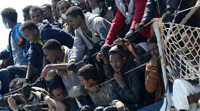 Migrants wait to disembark from the Italian navy vessel 'Chimera' in the harbour of Salerno [AP]
