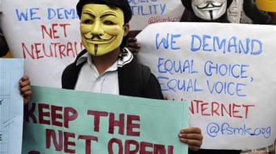 Indian activists at a demonstration supporting ''net neutrality'' in Bangalore on April 23, 2015. (AFP)