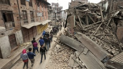 Thousands of people, too frightened to venture indoors, are camping out in streets of Kathmandu [AP]