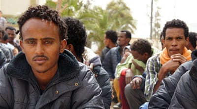 Libyan militias have reportedly targeted migrants with racist attacks, robberies, torture, and kidnappings [Rebecca Murray/Al Jazeera]