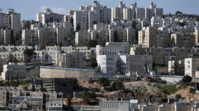 Thirty-six settlement buildings were being offered in Neve Yaakov and another 41 in neighbouring Pisgat Zeev [File: AFP]