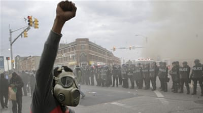 Police stand in formation during unrest following the funeral of Freddie Gray in Baltimore [AP]