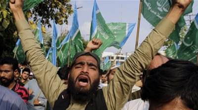 A supporter of Pakistan's Jamaat-e-Islami at a demonstration to condemn the execution of Mohammad Kamaruzzaman [AP]