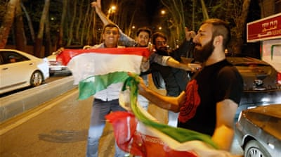 Iranians celebrate after nuclear talks on the streets of Tehran [EPA]