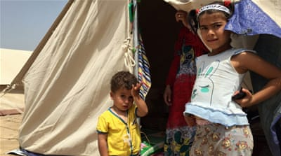 Displaced Iraqis shelter in Baghdad camps