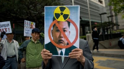 An activist holds an anti-North Korean placard during a rally in Seoul [AFP]