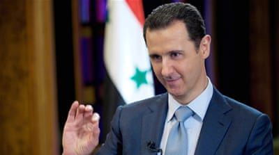 Syrian President Bashar al-Assad gestures during an interview with the BBC, in Damascus, Syria [AP]