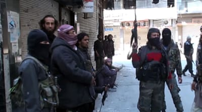 Reports: Rebels to leave Damascus suburbs under deal