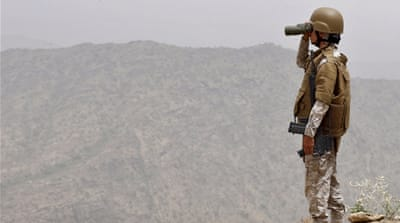 A Saudi soldier looks through binoculars at Saudi Arabia's border with Yemen [REUTERS]