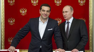 Putin and Tsipras attend a signing ceremony at the Kremlin in Moscow [REUTERS]