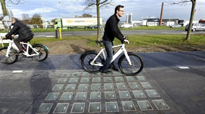 Engineers in the Netherlands say a novel solar road surface that generates electricity has proven more successful than expected [AFP]