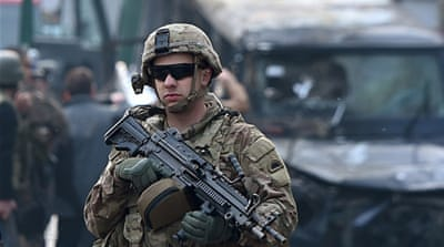 A US soldier keeps watch in front of the Iranian embassy in Kabul [AFP]