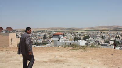 Syria's war haunts Jordanian border town