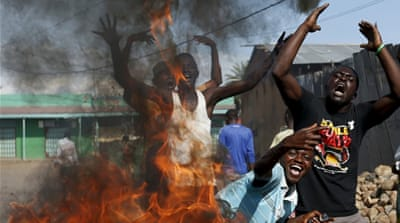 Demonstrators celebrate what they perceive to be an attempted military coup d'etat in the capital Bujumbura, Burundi [AP]
