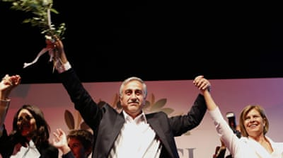 Turkish Cypriots' newly elected leader Mustafa Akinci with his wife Miral [AP]