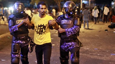 Riot police fired tear gas and baton-charged the late night protest, witnesses said [AP]