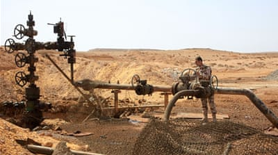 Syrian soldier at Jazel oil field, near Palmyra in the east of Homs province after they retook the area from ISIL [AFP]