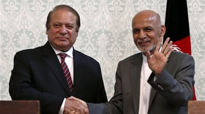 Afghan President Ashraf Ghani embraces Pakistani Prime Minster Nawaz Sharif at the Presidential palace in Kabul [AFP]