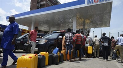 Nigerian motorists have borne the brunt of the shortages, with long queues at petrol stations in major cities [AFP]
