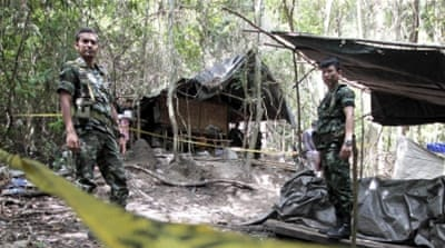 Bodies were exhumed from a mass grave across the Thai border earlier this month [File: Reuters]