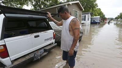 Days of heavy rain leave parts of Texas and Oklahoma under water, killing at least three people [EPA]