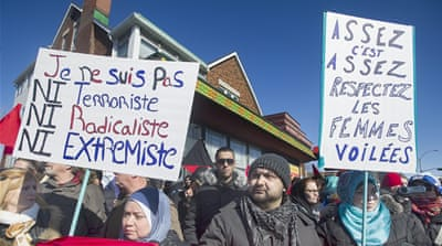 Members of the Muslim community attend a demonstration in Montreal [AP]
