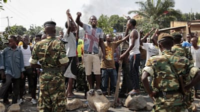 Opposition demonstrators confront army soldiers in Bujumbura, Burundi [AP]