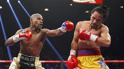 Mayweather defeated Pacquiao in the most lucrative boxing matches of all time [Reuters]