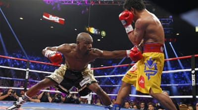 Manny Pacquiao, left, shakes hands with Floyd Mayweather Jr following their welterweight title fight [AP}