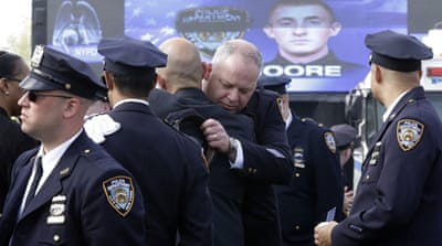 As many as 30,000 police officers from across the United States paid their respects at the Long Island funeral for Moore [AP]