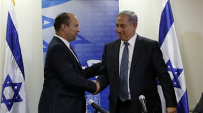 Netanyahu with the leader of the right-wing Jewish Home party, Naftali Bennett [AFP]