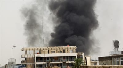 Smoke rises after a car bomb explodes in Baghdad's Karrada neighbourhood, known for its restaurants and cafes [Reuters]