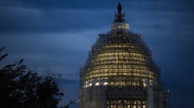 The US Capitol is illuminated at dusk in Washington, DC [Getty]