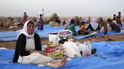 Yazidis still try to come to terms with the aftermath of ISIL's brutal assault [AP]