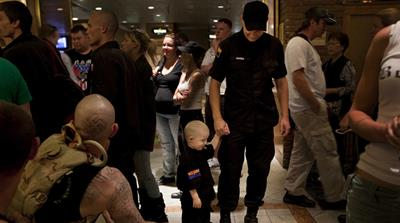 National Socialist Movement members and their families get organised in a hotel lobby before marching on the street in front of the Mexican consulate in Las Vegas. June 2010 [Julie Platner]