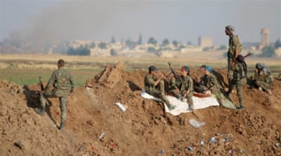 Syrian Kurdish forces capture key ISIL-held town